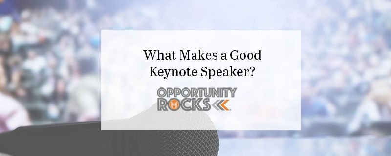 microphone in front of a motivational speaker crowd